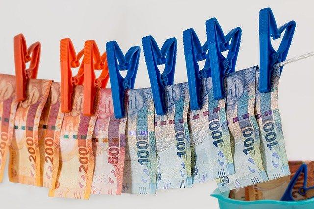 money drying on washing line